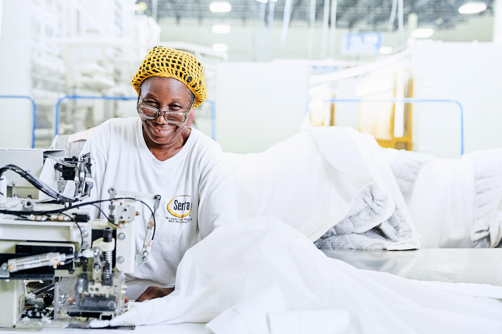 Smiling woman working on sewing machine