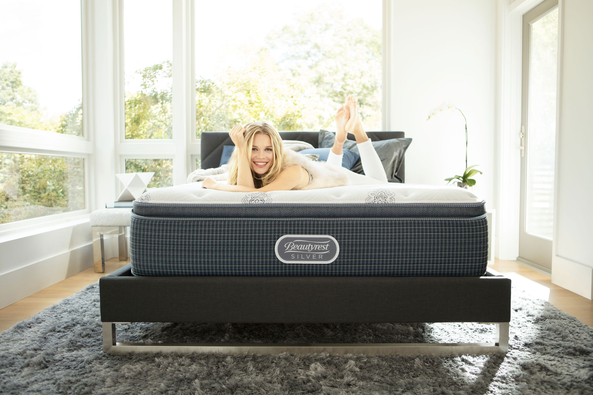 Woman smiling at camera on Beautyrest mattress