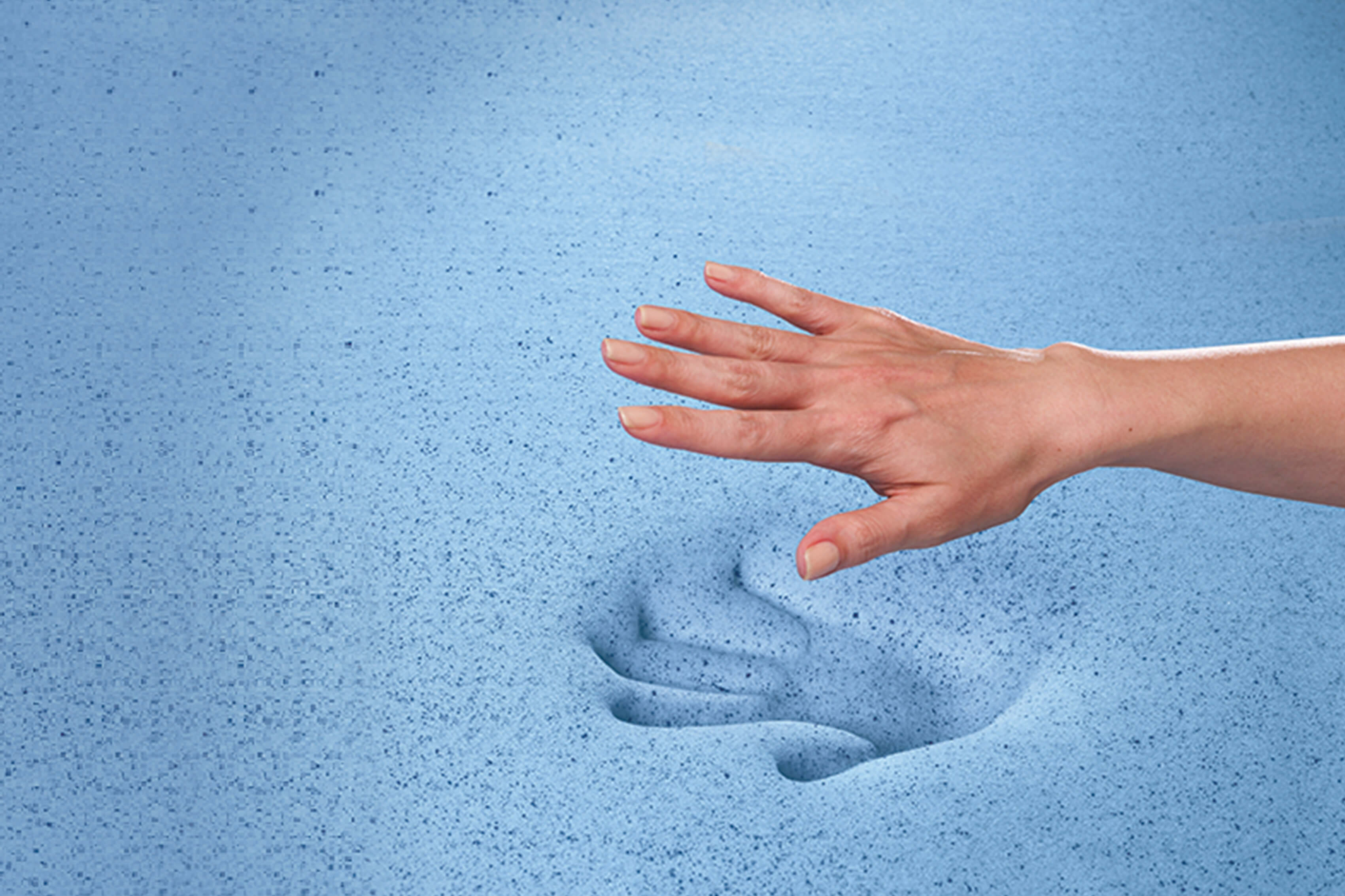 Hand leaving print in foam mattress